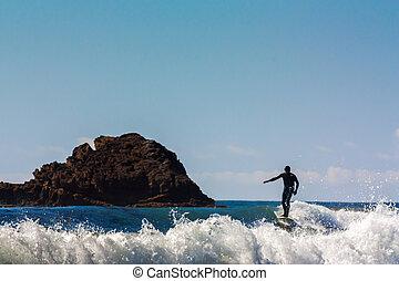 Surfer Comes Ashore at Leo Carrillo State in Malibu,...