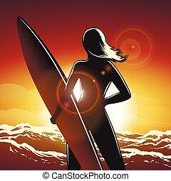 Surfer girl on a beach