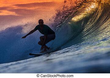 Surfer on Amazing Wave at sunset time, Bali island.