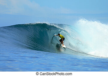 Surfer on perfect blue tropical wave, Indonesia - Surfer in...