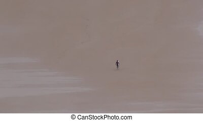 surfer on sand 30 - surfer at beach in Asturias Spain Europe...