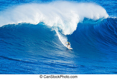 Surfer riding giant wave - Extreme surfer riding giant ocean...