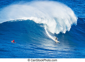 Surfer riding giant wave