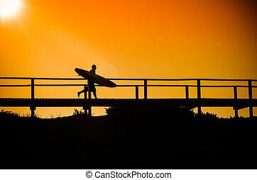 Surfer running to the beach