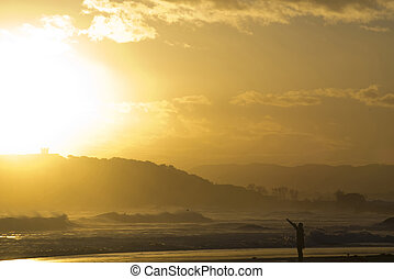 surfer silhouette at dawn