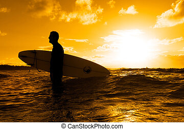Surfer silhouette - Silhouette of a surfer at sunset