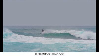 Surfer surfing on sea waves 4k - Surfer surfing on sea waves...