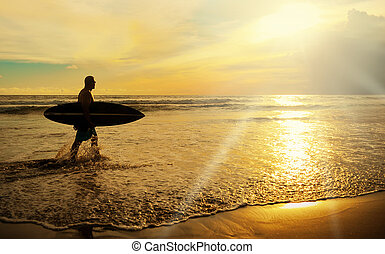 Surfer with board