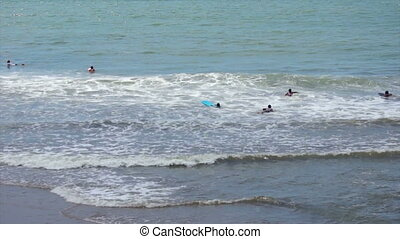 Surfers - A small group of surfers