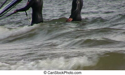 Surfers are trying to catch the perfect wave