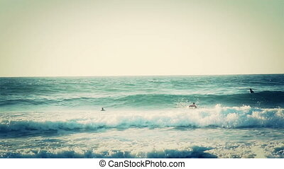 Surfers enjoying the wave seawater sport surfing - Surfers...