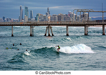 GOLD COAST - OCT 10 2014: Surfers in the Spit beach. It is a very popular surfing beach in Surfers Paradise Gold Coast Queensland, Australia.