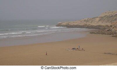 surfers on beach, Morocoo