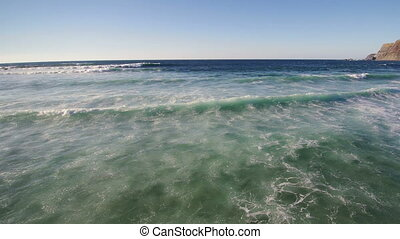 Surfers on waves of Atlantic Ocean in Portugal - Surfers on...