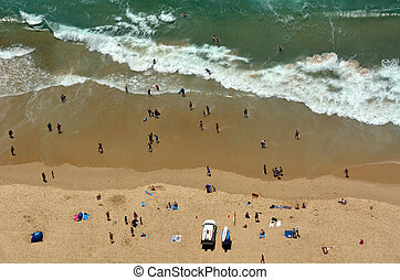 SURFERS PARADISE - NOV 14 2014:Visitors on main beach in Surfers Paradise. It one of Australia's iconic coastal tourist destinations, drawing about 10 million tourists every year from all over the world.