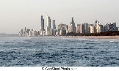 Surfers Paradise skyline with the Spit Beach at sunrise in...