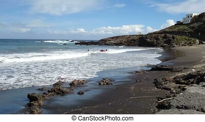 Surfers swimming in the sea