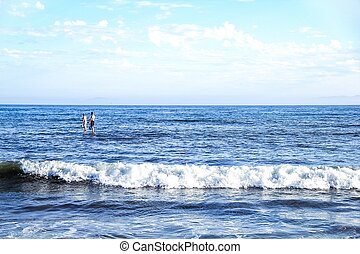 surfing at the beach in summer