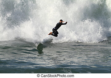 surfing - good surfer riding a wave