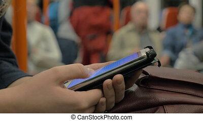 Surfing internet on cell in underground train