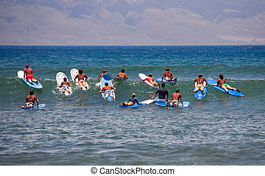 Surfing Lessons - Surf school - several people on surfboards...