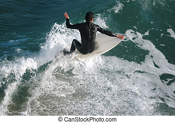 surfing - young boy surfing
