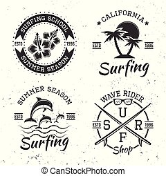Surfing set of four black vector vintage emblems