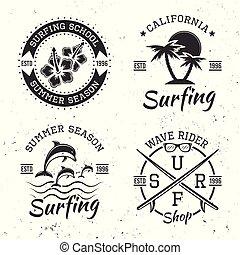 Surfing set of four black vector vintage emblems