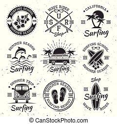 Surfing set of nine black vector vintage emblems