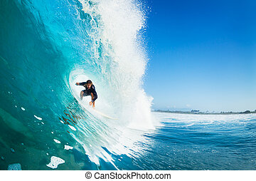 Surfing - Surfer on Blue Ocean Wave in the Tube Getting...