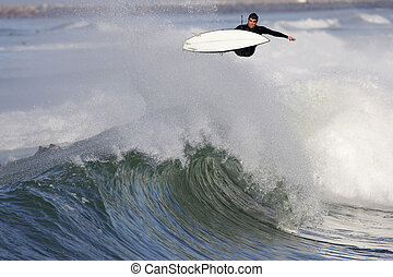 surfing wave - good surfer in action on a powerful wave