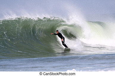 surfing wave - good surfer in action on a wave