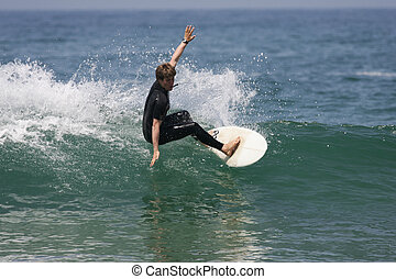 surfing wave - good surfer on a powerful wave