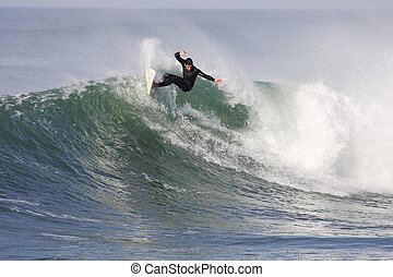 surfing wave - surfer in action on a wave