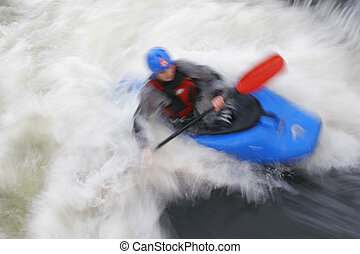Surfing Whitewater - A motion blurred shot of a kayaker...