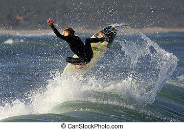 Surfing with style - A young talented surfer pulls a big air...