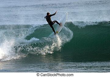 Malibu surfer taking a wave head-on.