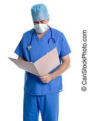 Surgeon examining notes. - Surgeon in scrubs examining his ...