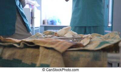 Surgeon in gloves preparing instruments before surgery. Doctor is preparing the tools for surgery. Close up