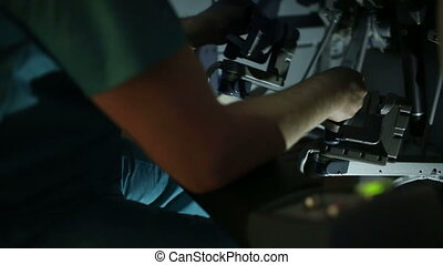 operating a robotic surgery machine - Surgeon operating a...