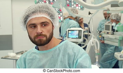 Surgeon thinks about some problem - Bearded surgeon thinking...