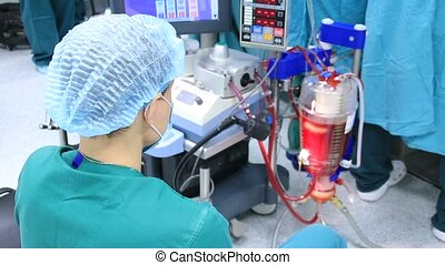 Surgery assistant operating heart lung machine