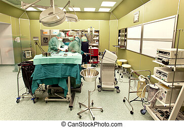 Surgery in operating room - Blurred figures of doctors ...