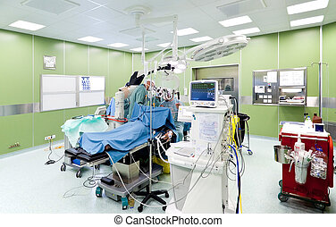 Surgery in operating room - Medical team performing surgery...