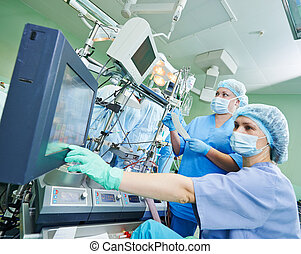 surgery nurse working during operation - Surgery assistant ...