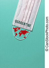 Surgical mask with a red map of the world, covid-19 outbreak virus quarantine