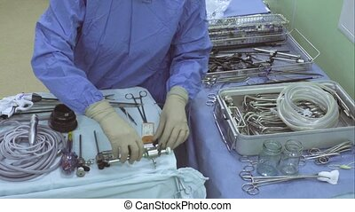 Surgical nurse preparing instrument for operation