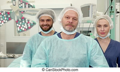 Surgical team poses at the surgery room - Modern surgical...