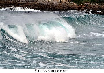 Surging Wave - Surging wave breaking on the coastline of...