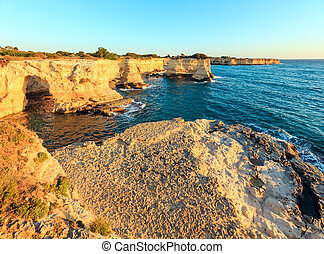 Surise Faraglioni at Torre Sant Andrea, Italy - Picturesque...
